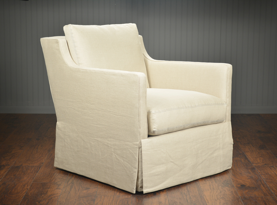 Upholstered And Skirted Swivel Arm Chair